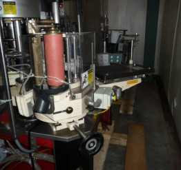 Used 'as is' Krones Universela Cut & Stack Paper Labeler - Set Up For 12 Once Long Neck Beer Bottles